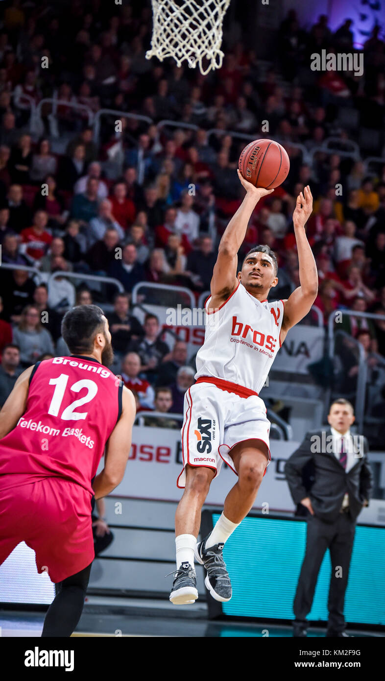 Germany, Bamberg, Brose Arena, 03 December 2017 - (From L-R): Martin Breunig (Telekom Baskets Bonn, #12) looks on - Stock Image