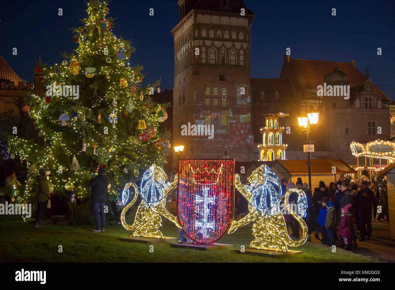 Coat Of Arms Of Gdansk And Christmas Decorations In Old Town In