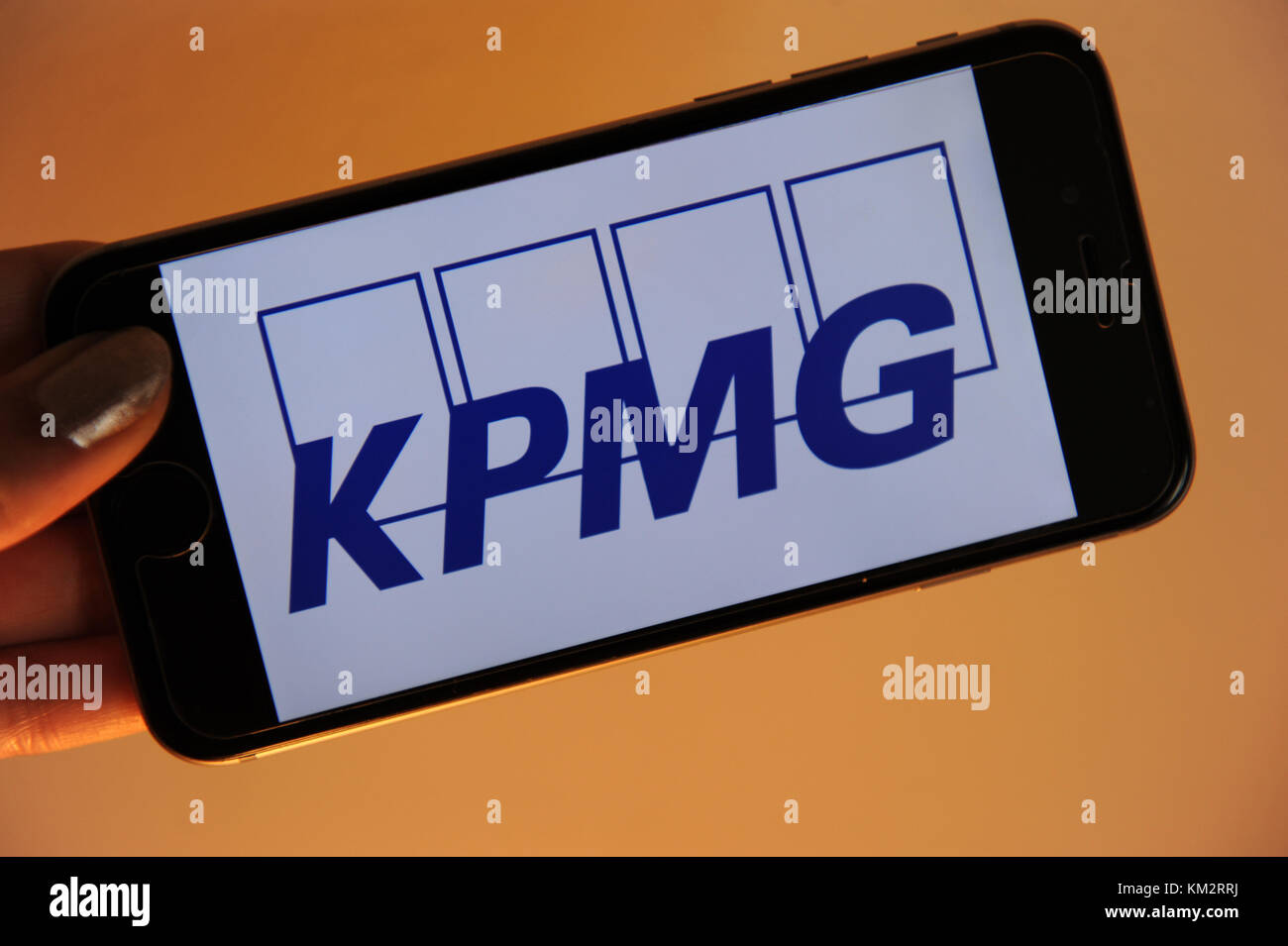 The logo for auditor KPMG on a phone - Stock Image