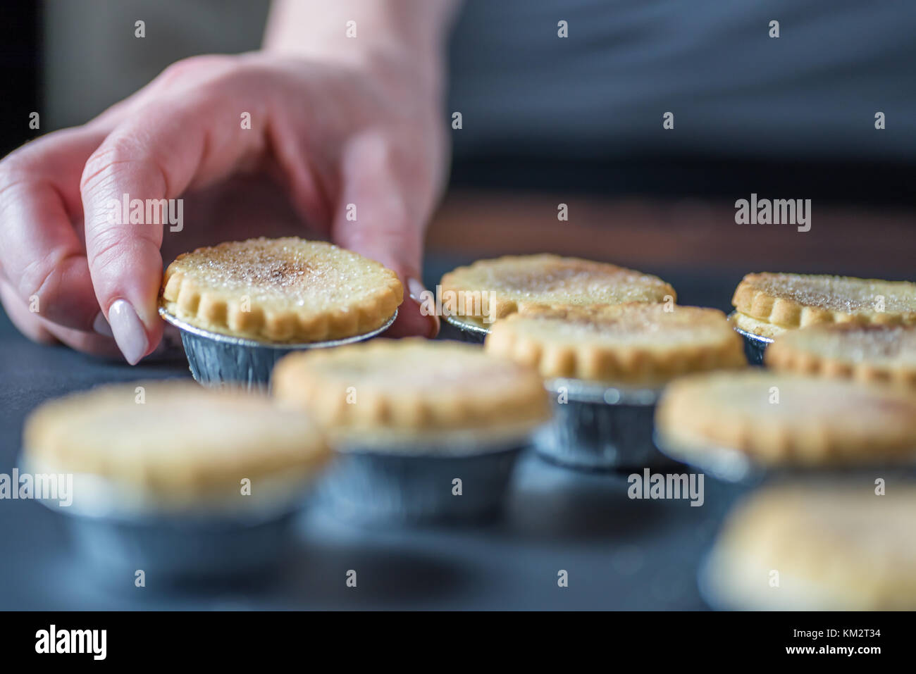 Closeup View Female Hands Holding Christmas Mince Pies. - Stock Image