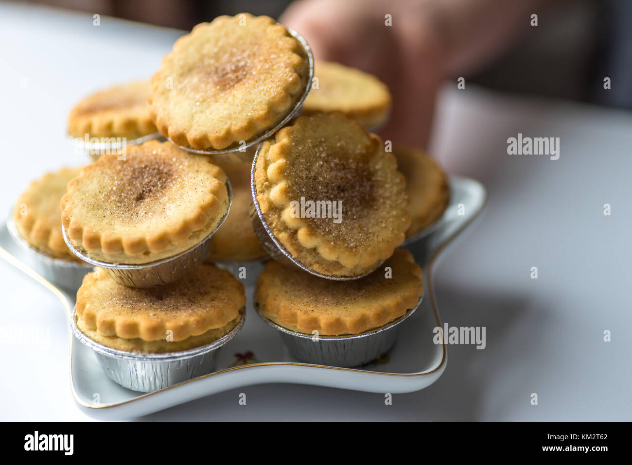 Closeup View Spicy Christmas Mince Pies on Star Shape Plate. - Stock Image
