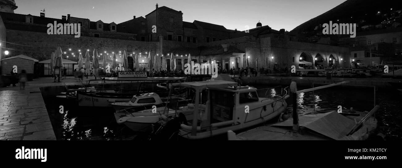 Boats in the Old Port of Dubrovnik at night, Dubrovnik-Neretva County, Dalmatian coast, Adriatic Sea, Croatia, Balkans, - Stock Image
