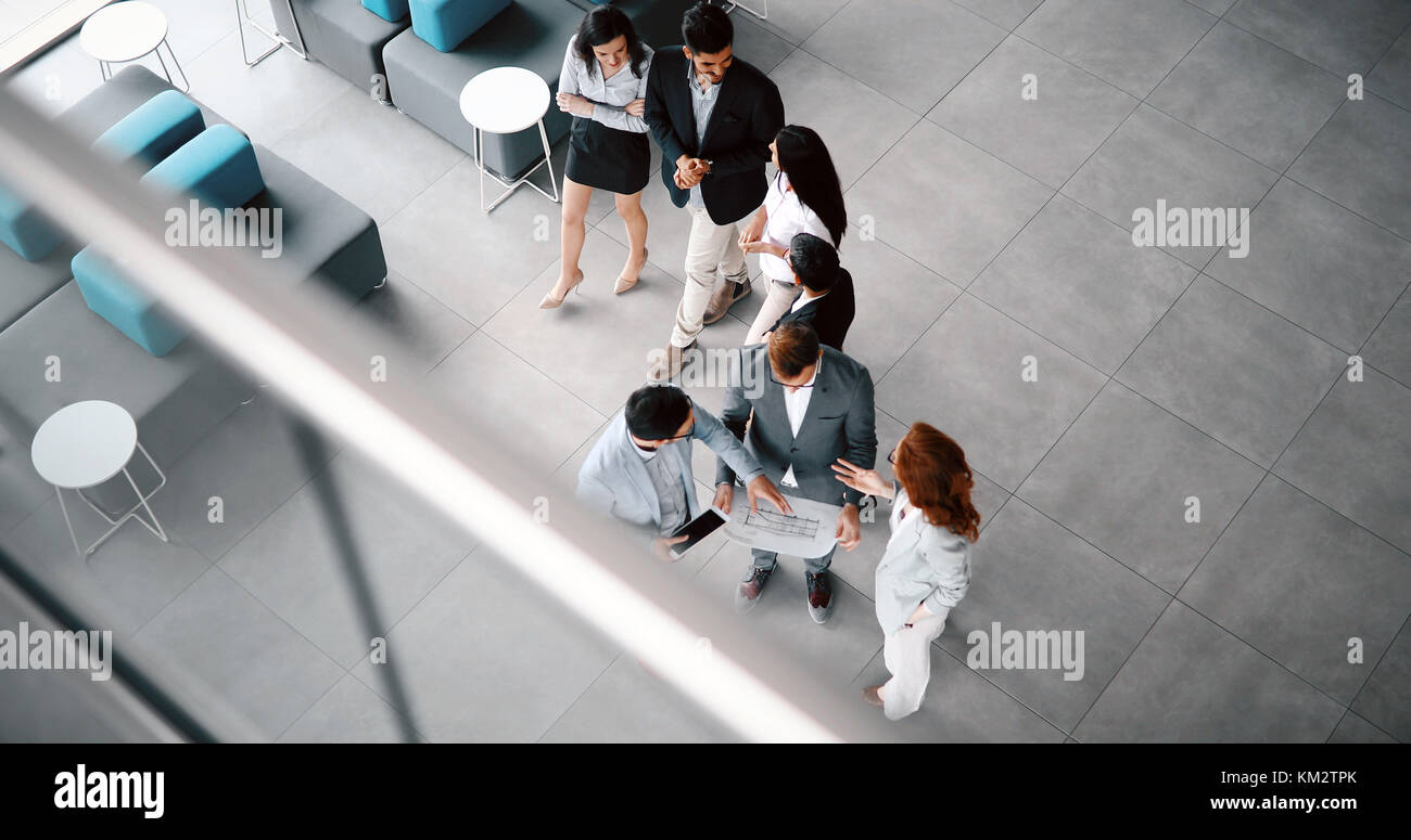 Corporate teamworking colleagues in modern office - Stock Image