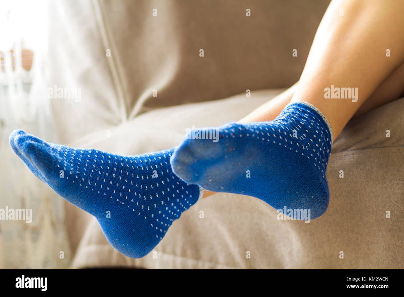 Woman Feet In Blue Socks Relaxing And Comfort Holiday Concept