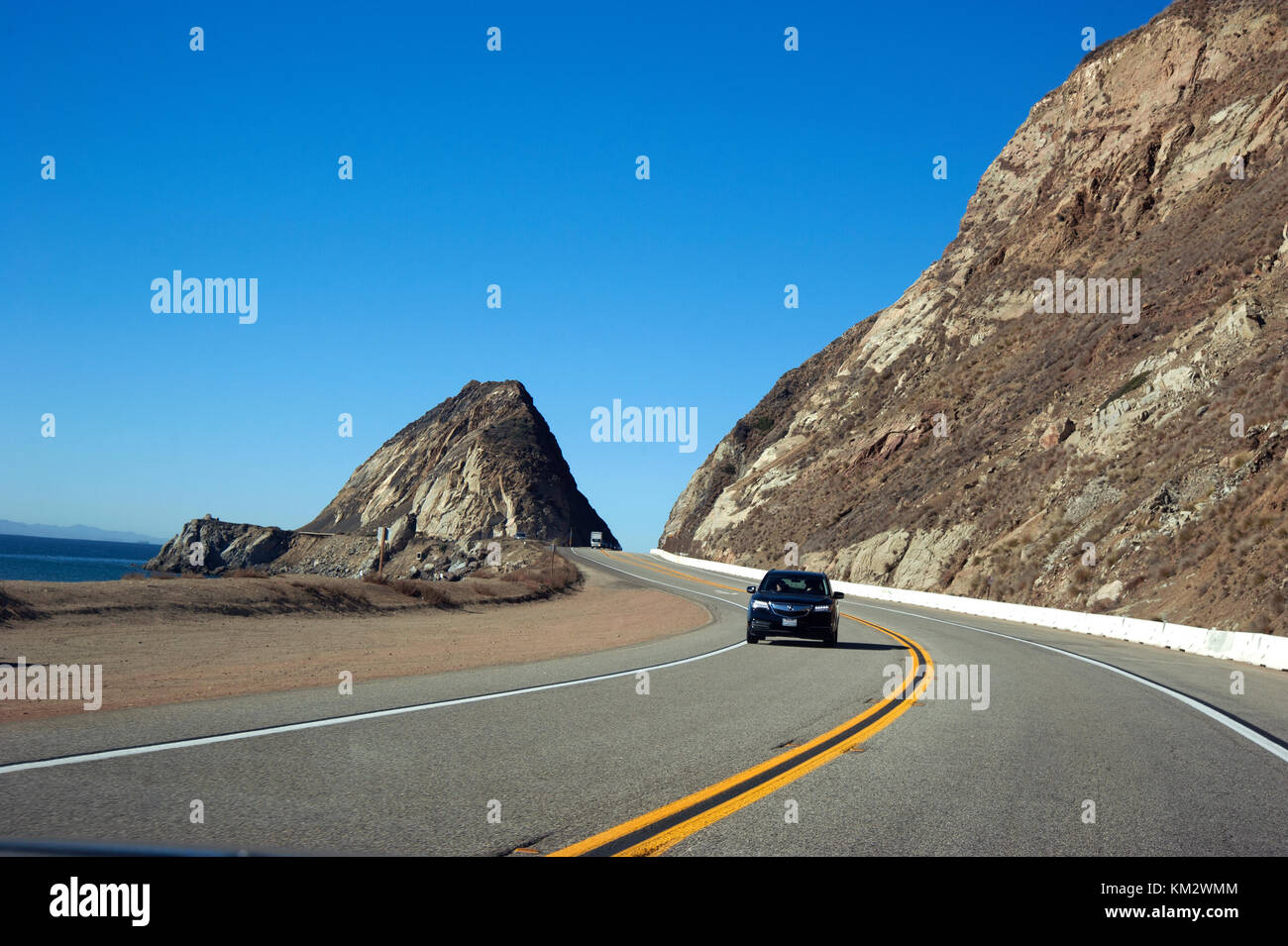 Car on Pacific Coast Highway heading south from north of Malibu to Los Angeles. - Stock Image