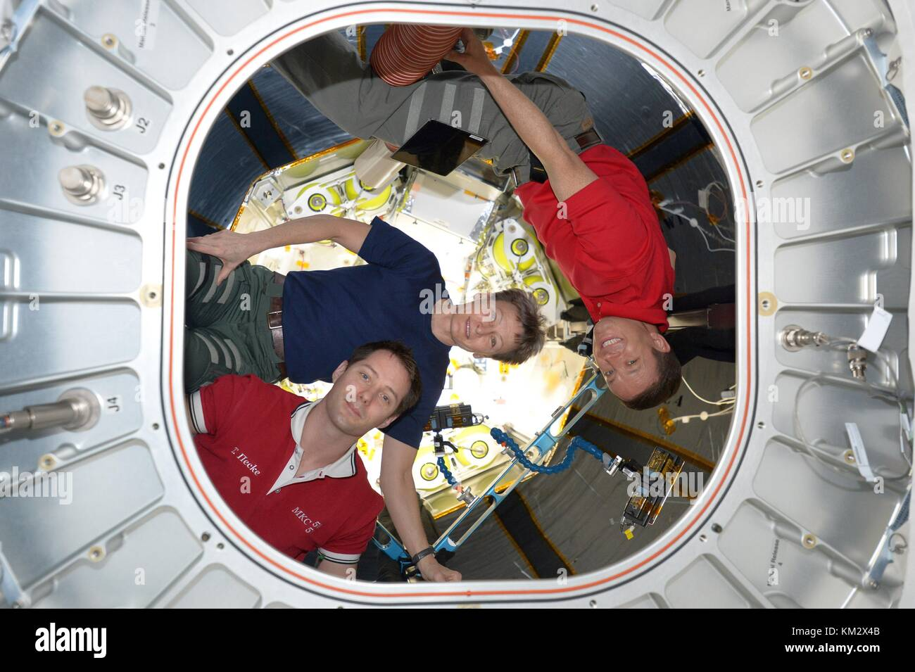 Expedition 52 American astronaut Jack Fischer, right, Peggy Whitson, center, and French astronaut Thomas Pesquet - Stock Image
