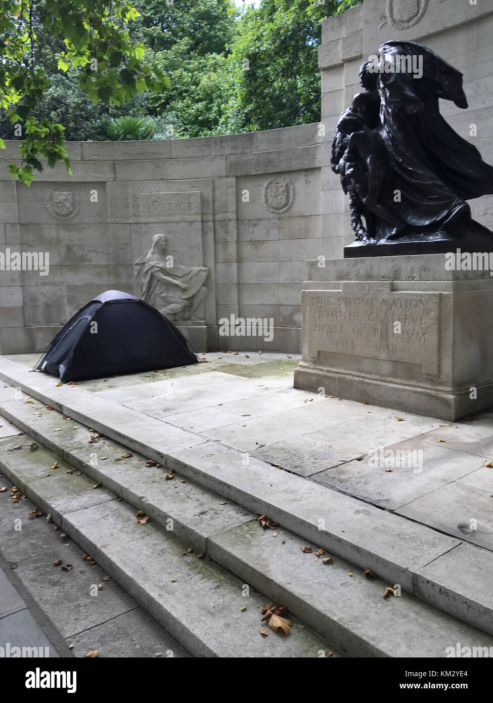 Black camping tent has been set up near the Anglo-Belgian Memorial on Victoria Embankment. - Stock Image