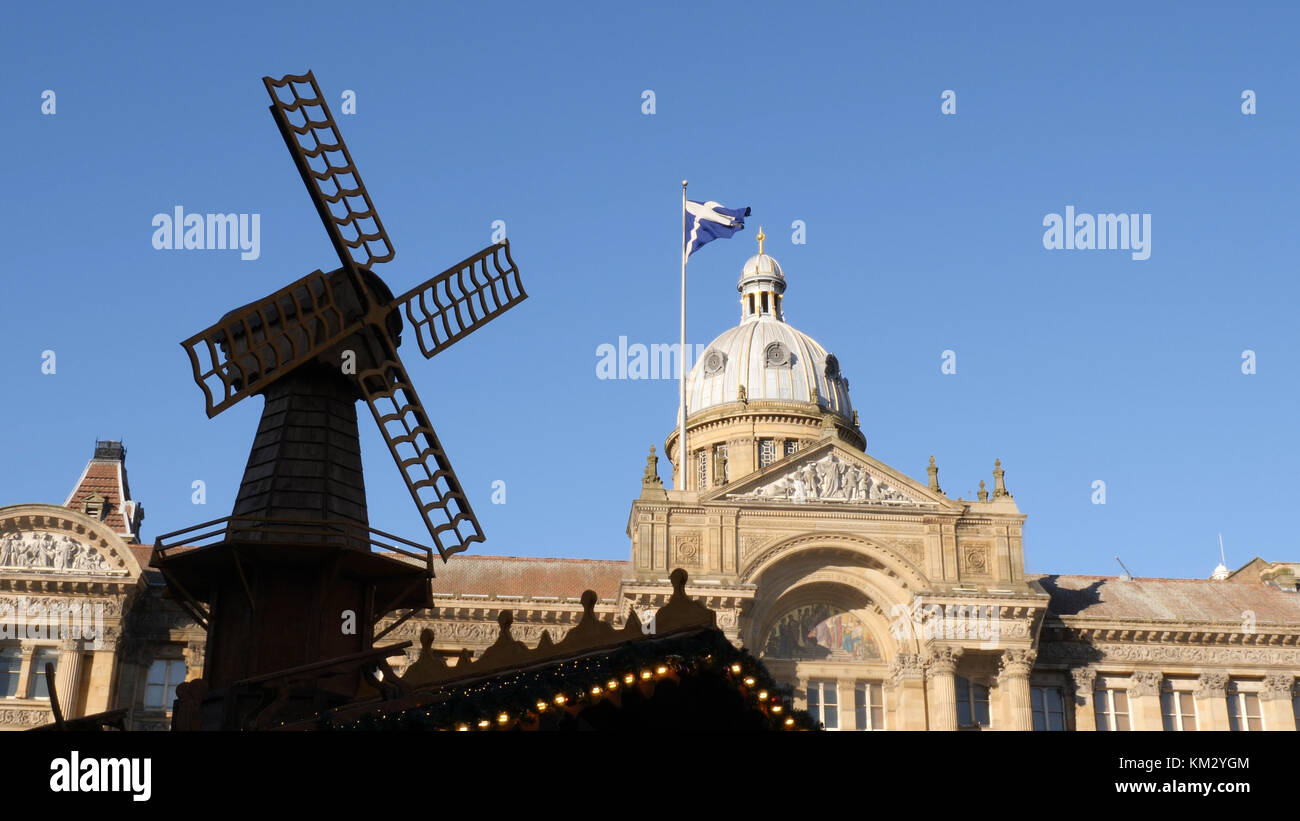 National flag of Scotland on a flagpole over Birmingham. - Stock Image