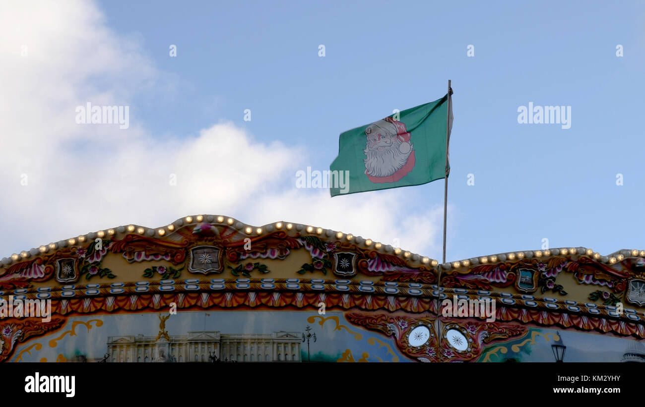Festive Christmas flag on a flagpole over Birmingham Christmas Market. - Stock Image