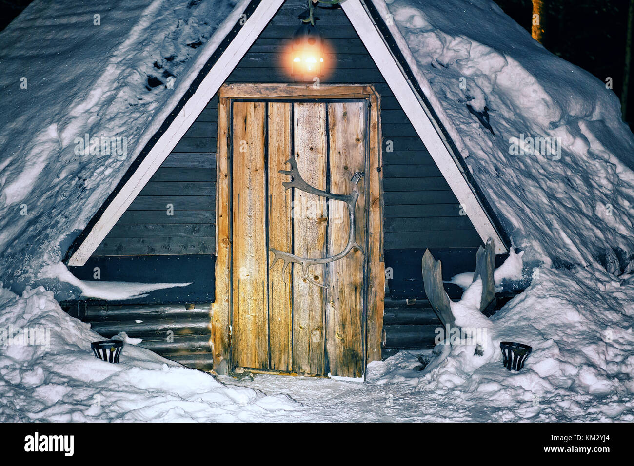 Rovaniemi, Finland - March 4, 2017: Lappish traditional house at the reindeer farm in winter Rovaniemi, Lapland, - Stock Image