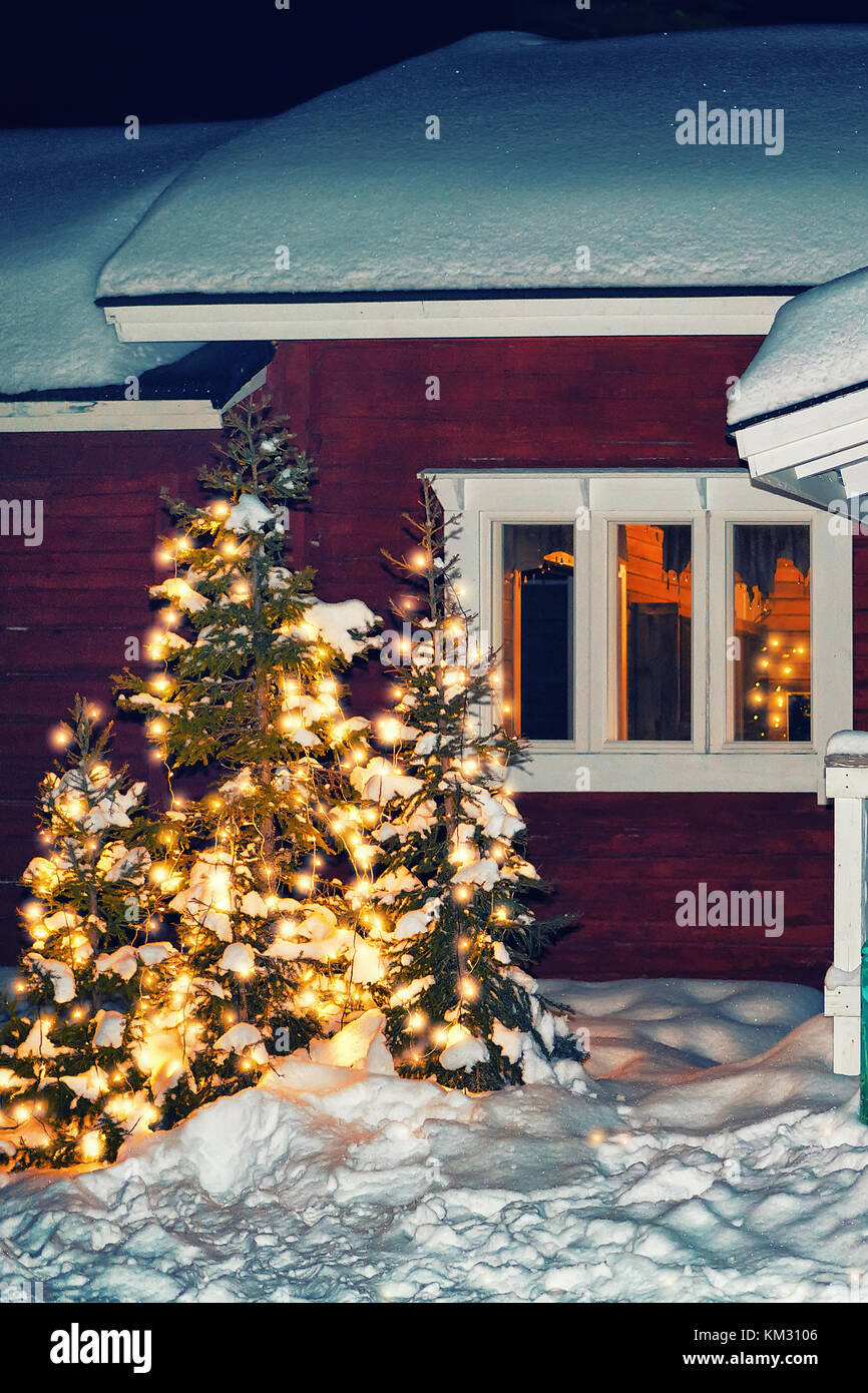 House at the reindeer farm in winter Rovaniemi, Lapland, Finland. Night snowfall. Toned - Stock Image