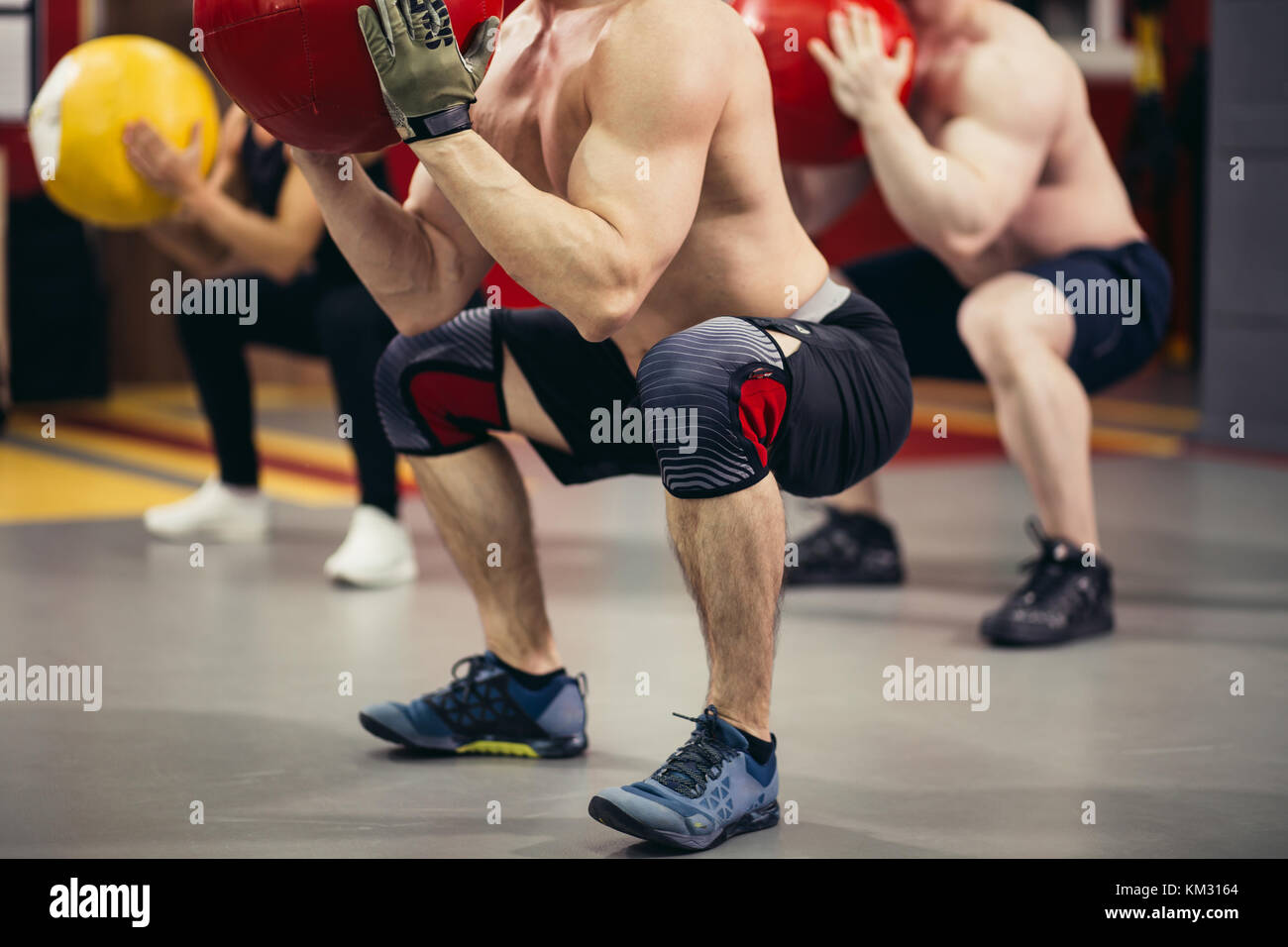 Cross fit ball fitness workout - Stock Image