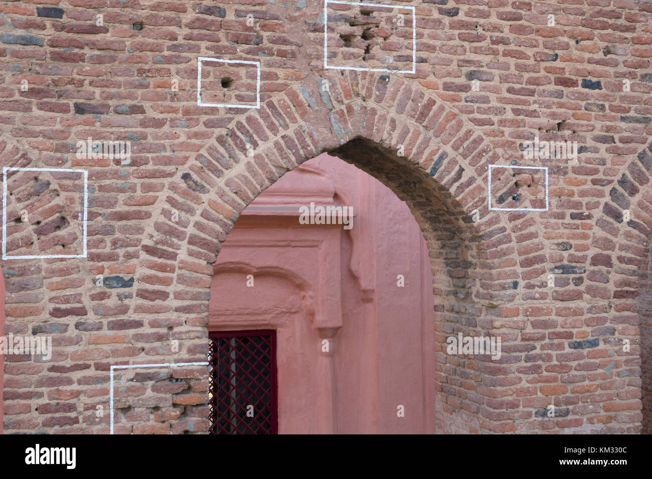 Machine gun bullet holes in brick wall at Jallianwala Bagh, Amritsar, where the British Army opened fire and massacred Stock Photo