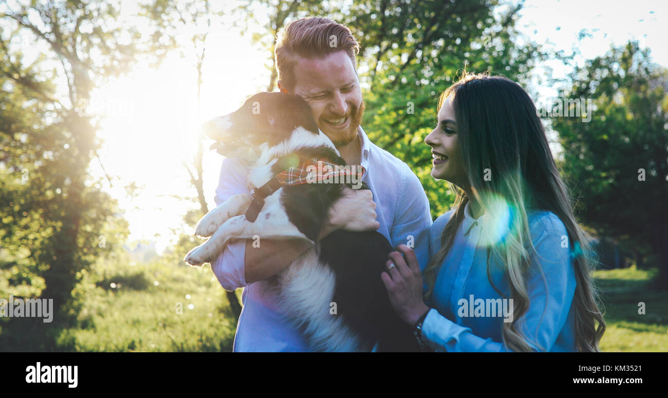 Romantic couple in love walking dogs and bonding Stock Photo