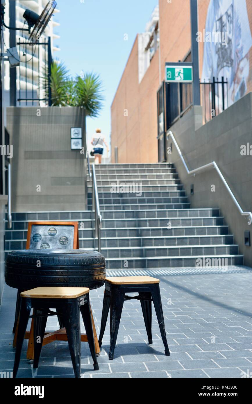 Table made from a car tyre, City Lane and City Arcade, a relatively new local entertainment hub, Townsville, Queensland, - Stock Image