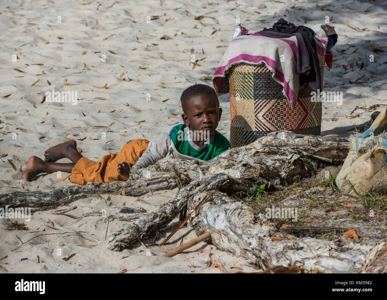 Young Malagasy boy play in the sand. Madagascar, Africa. - Stock Image