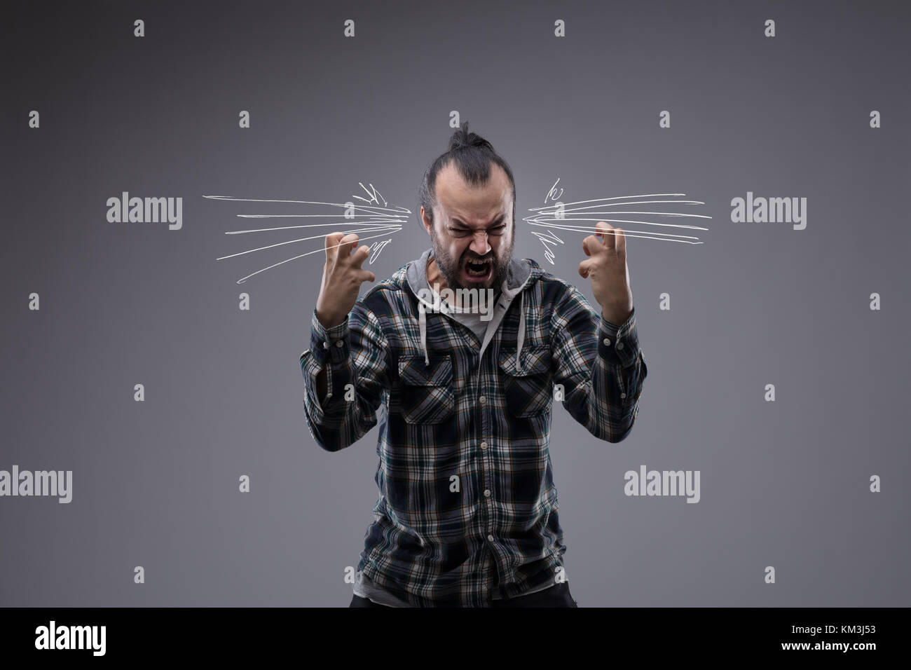 Angry man screaming and throwing a temper tantrum with clenched fists and hand drawn acoustic or noise icons on - Stock Image