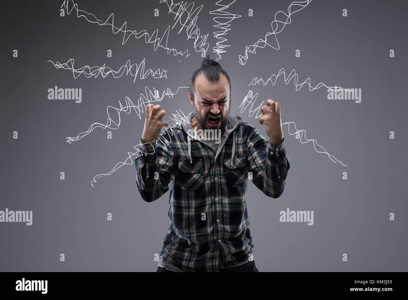 Man in a rage throwing a temper tantrum screaming and clenching his fists with hand drawn squiggles of emotion or - Stock Image