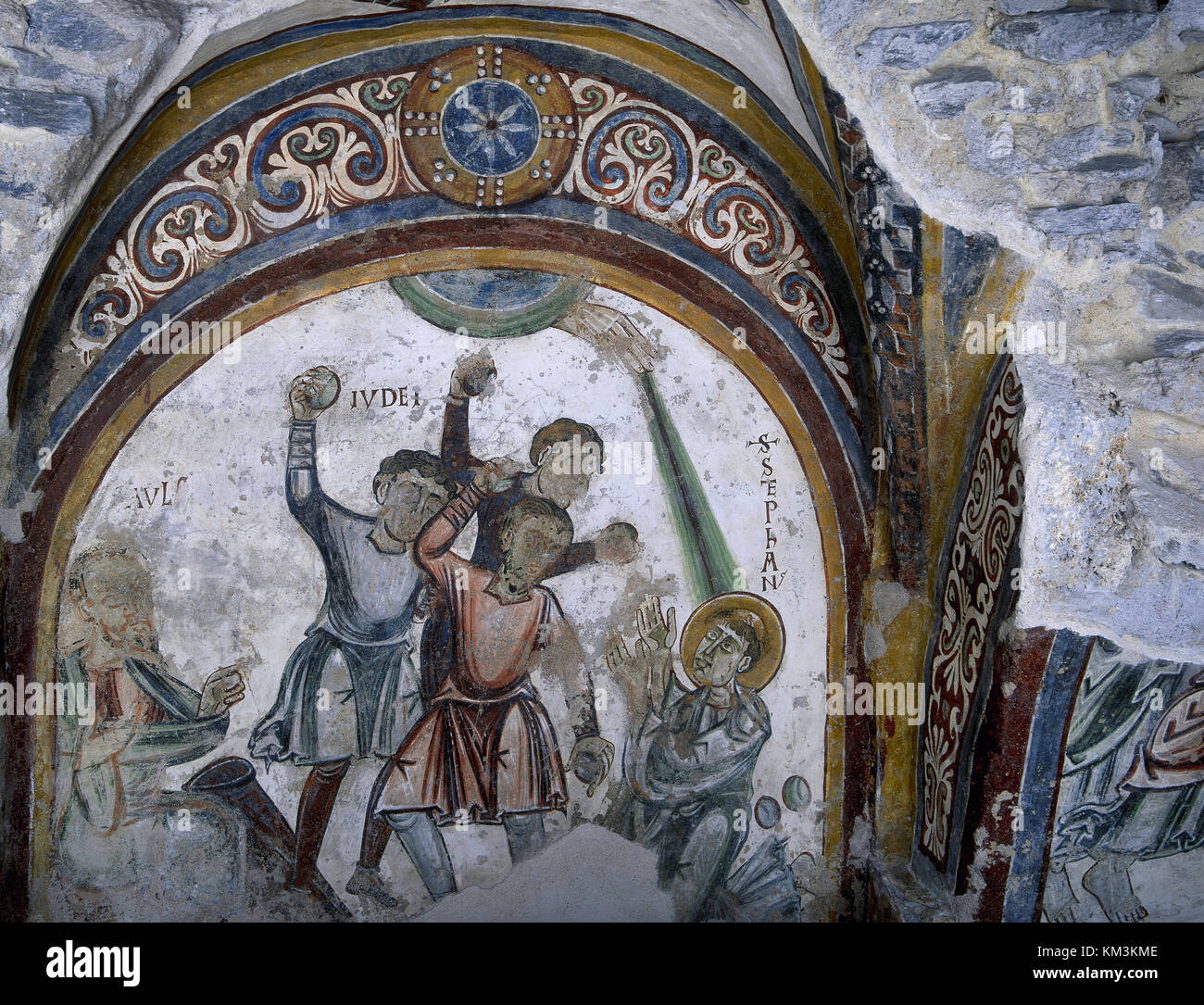 Saint Stephen (d. 34), first martyr of Christianity. Medieval frescos, 11th century. Stoning of st. Stephen. Novalesa - Stock Image