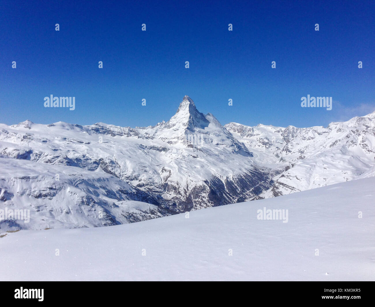 """Panoramic view of Matterhorn from """"Sunegga"""" station in front of a blue sky - Stock Image"""