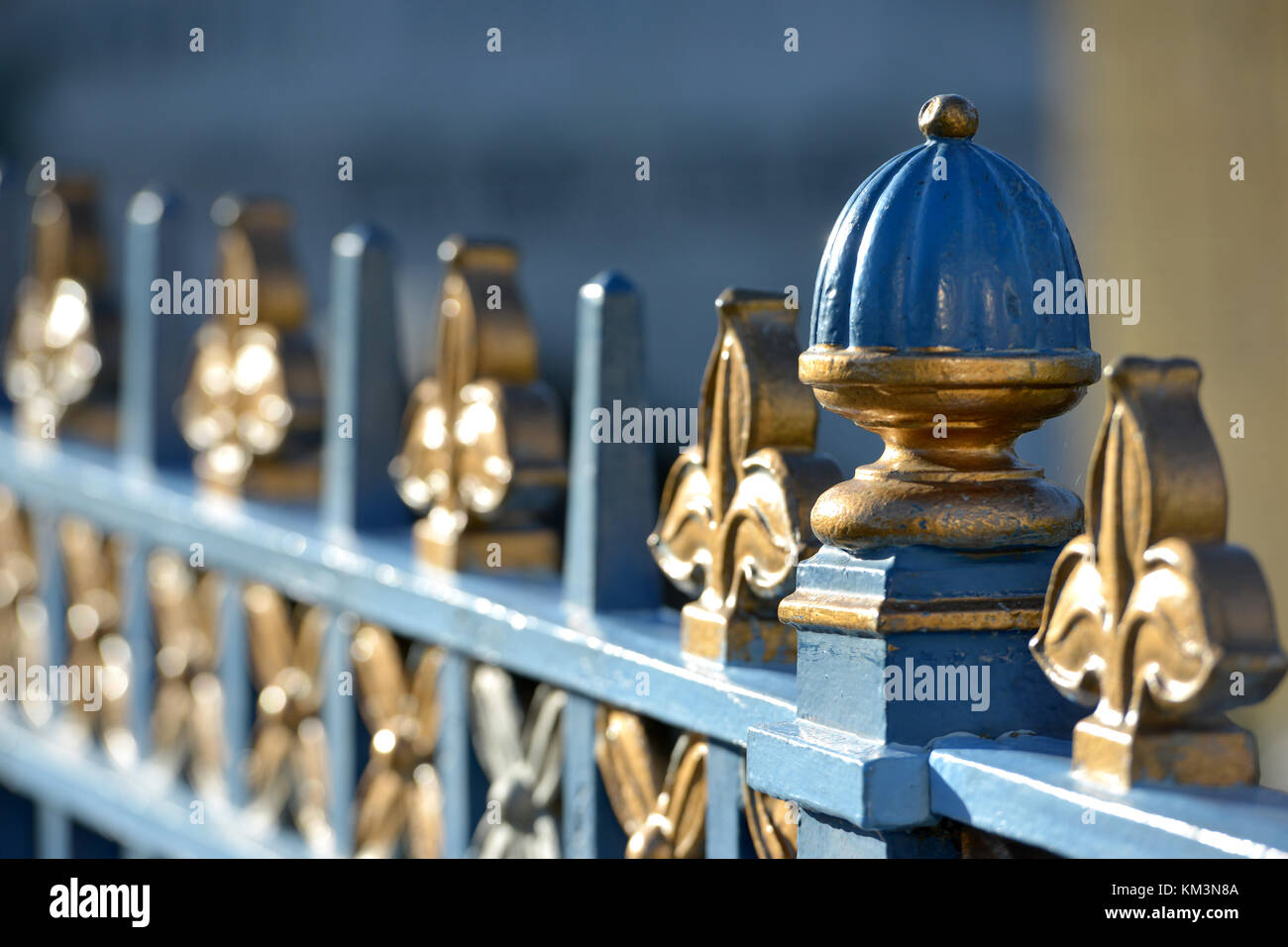 Blue and gold railings in Little Venice, City of Westminster, London, on an autumn day. - Stock Image