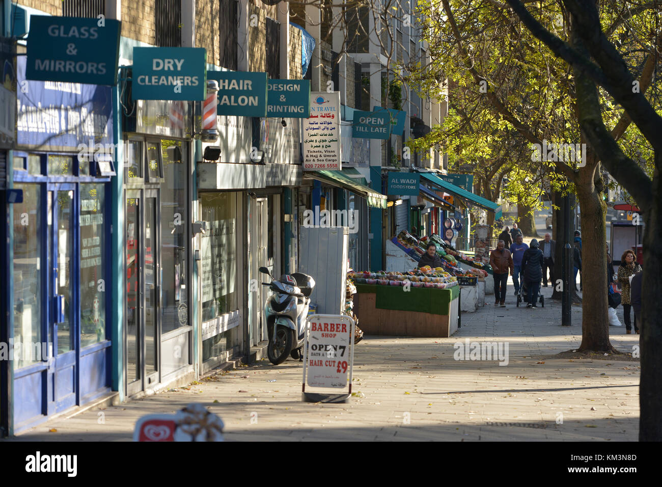 Small independent shops on Harrow Road, London. - Stock Image