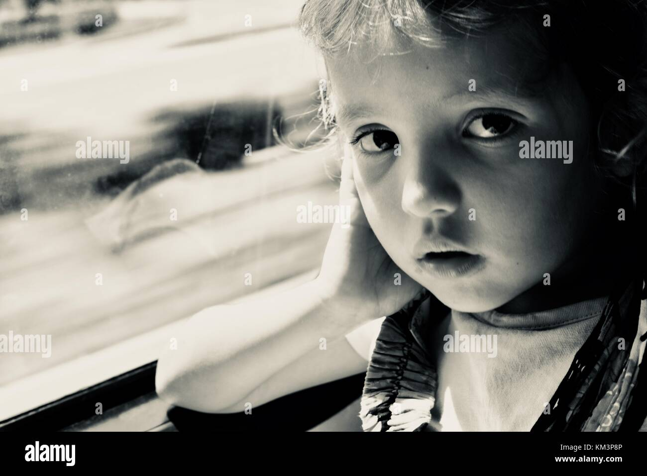 Young girl looking at camera and thinking, Townsville, Queensland, Australia - Stock Image