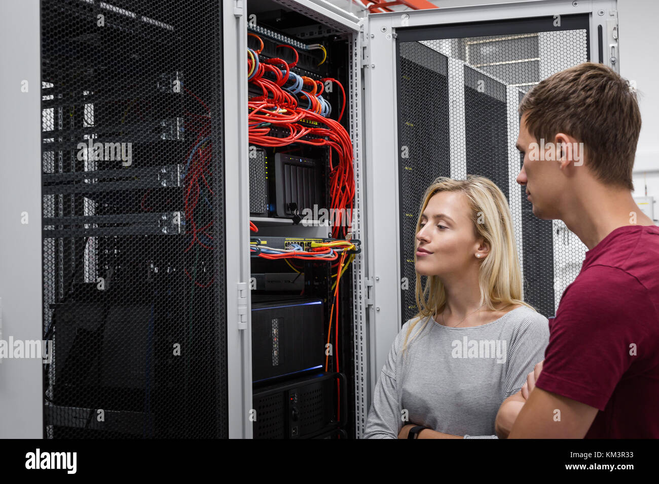 team of busienss people working in server room Stock Photo