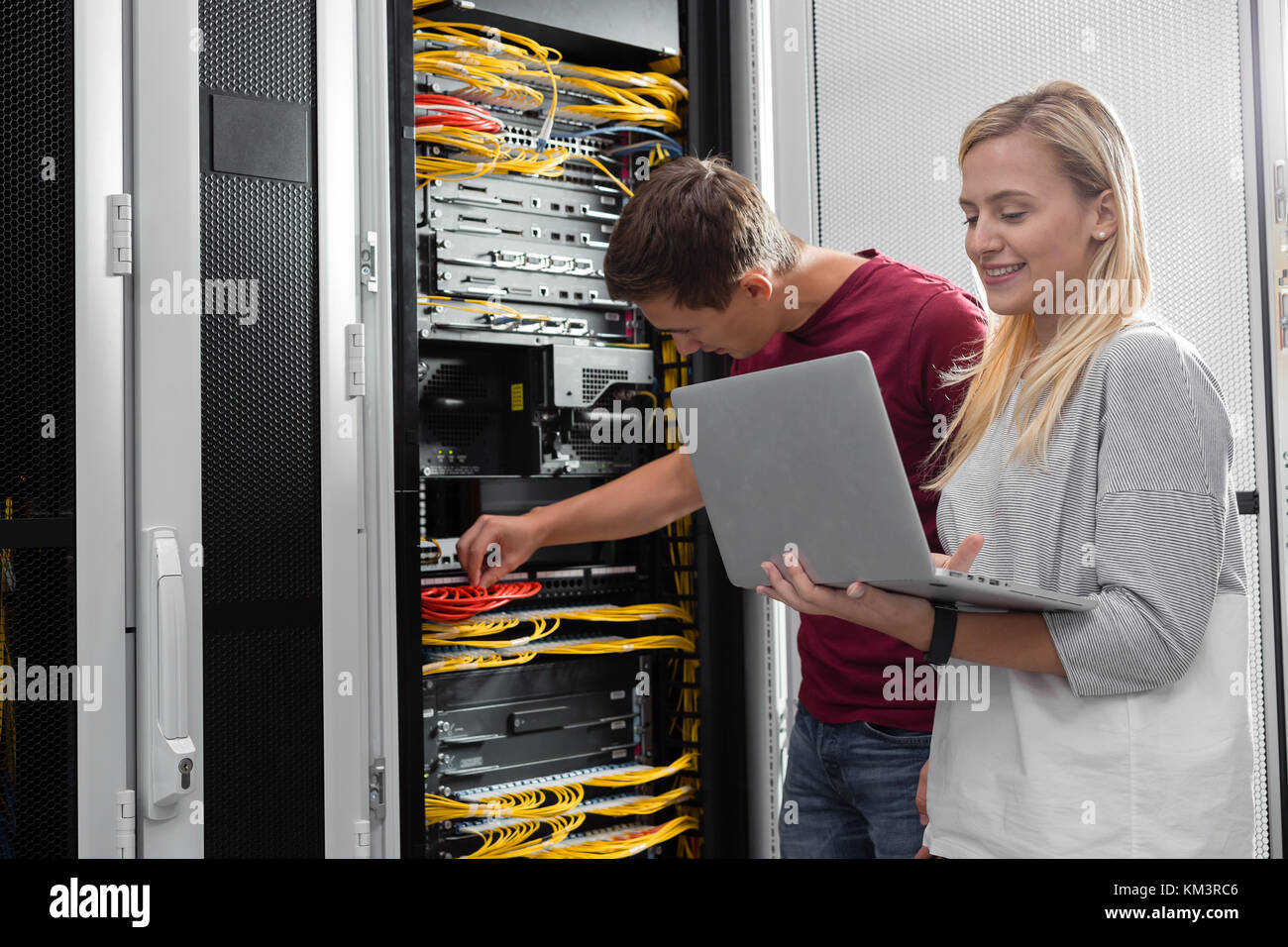 team of busienss people working in server room Stock Photo
