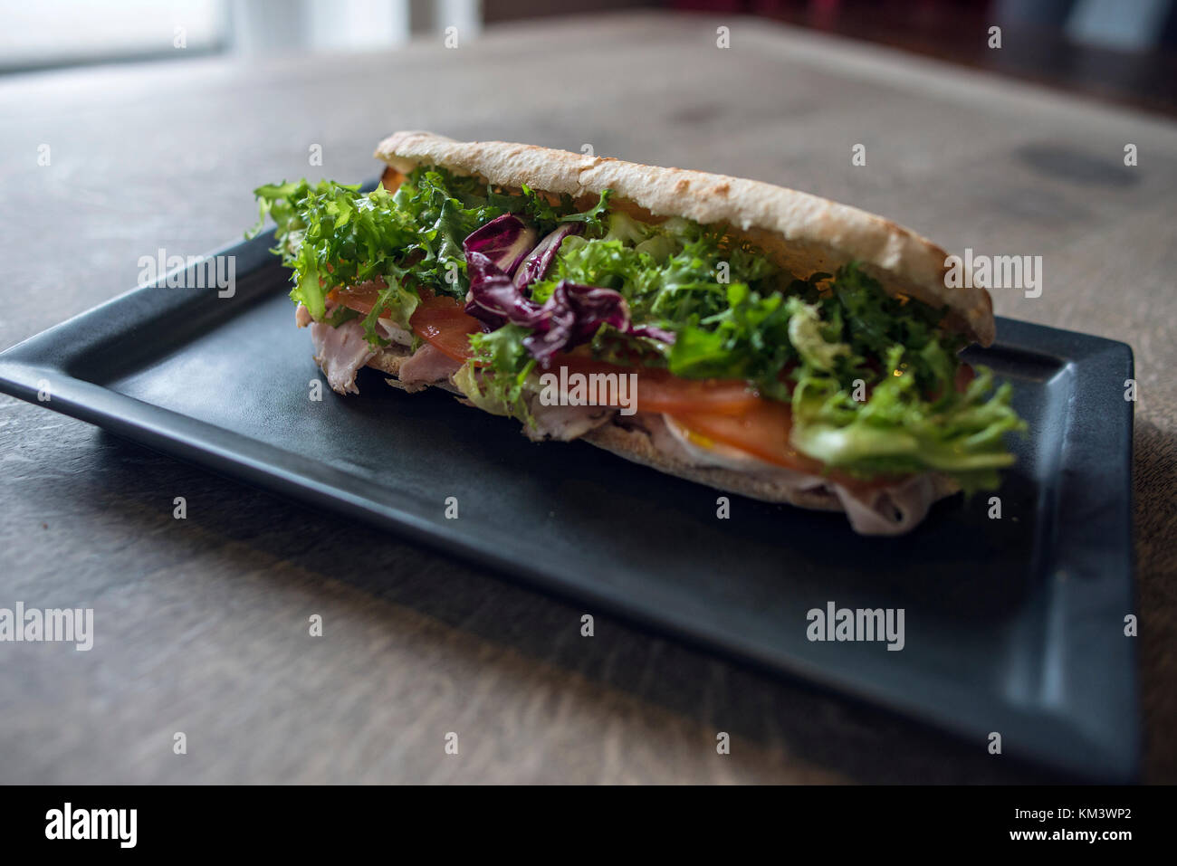 Authentic Italian Pizza and Sandwiches on Rustic Backdrop - Stock Image