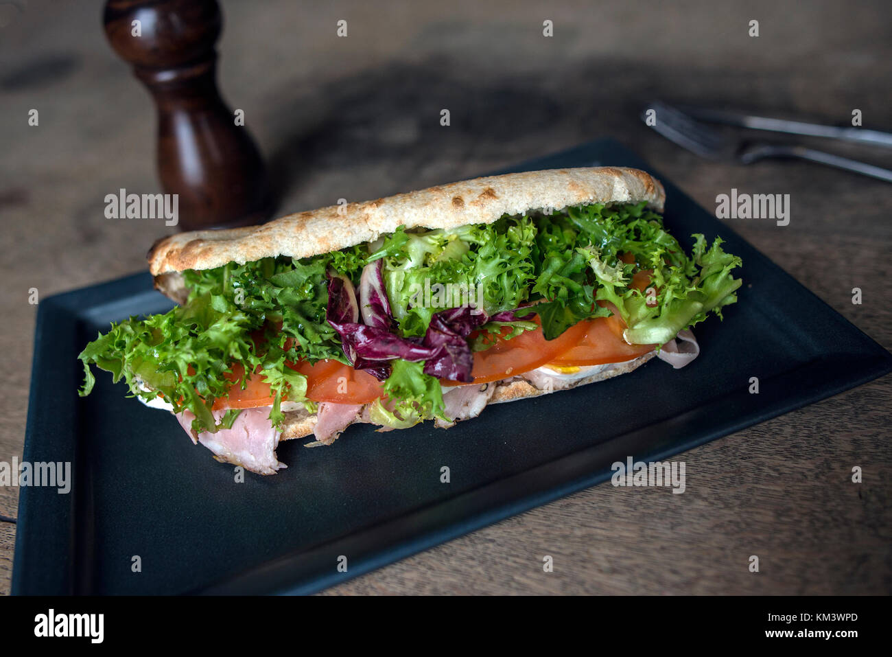 Authentic Italian Pizza on Rustic Surface - Stock Image