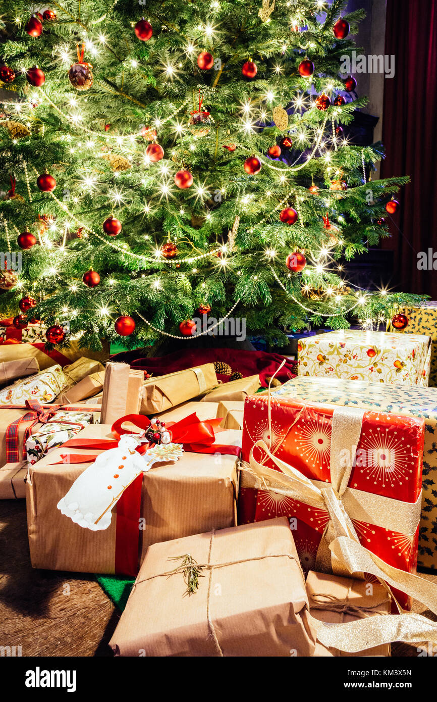 The Christmas tree surrounded by presents for a Victorian yuletide at Chastleton House.  December 2017 - Stock Image