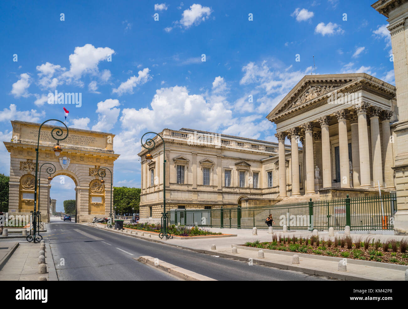 France, Hérault department, Montpellier, Rue Foch, view of the triumphal arch of Porte du Peyrou and the Court - Stock Image