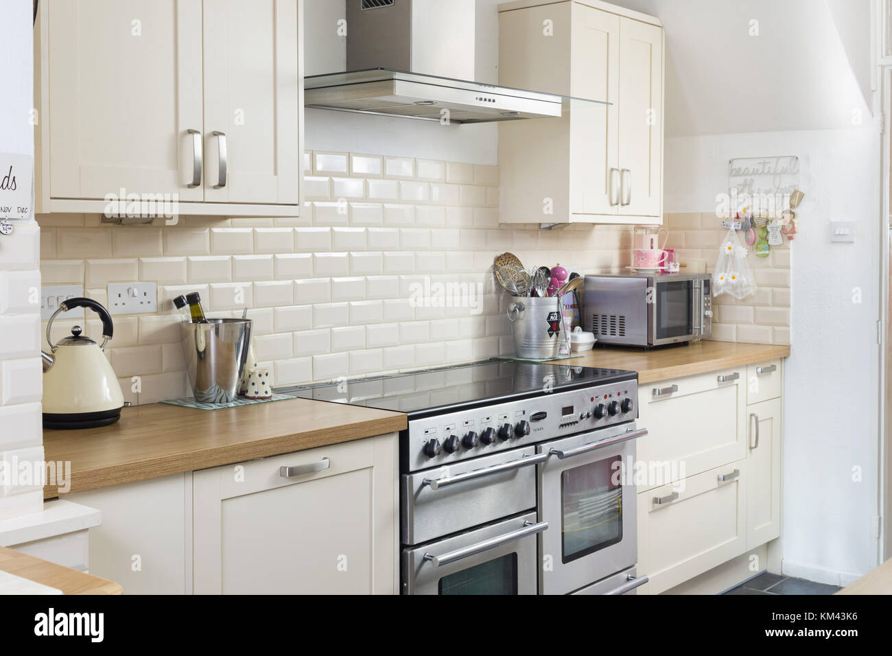 A contemporary kitchen with range cooker - Stock Image