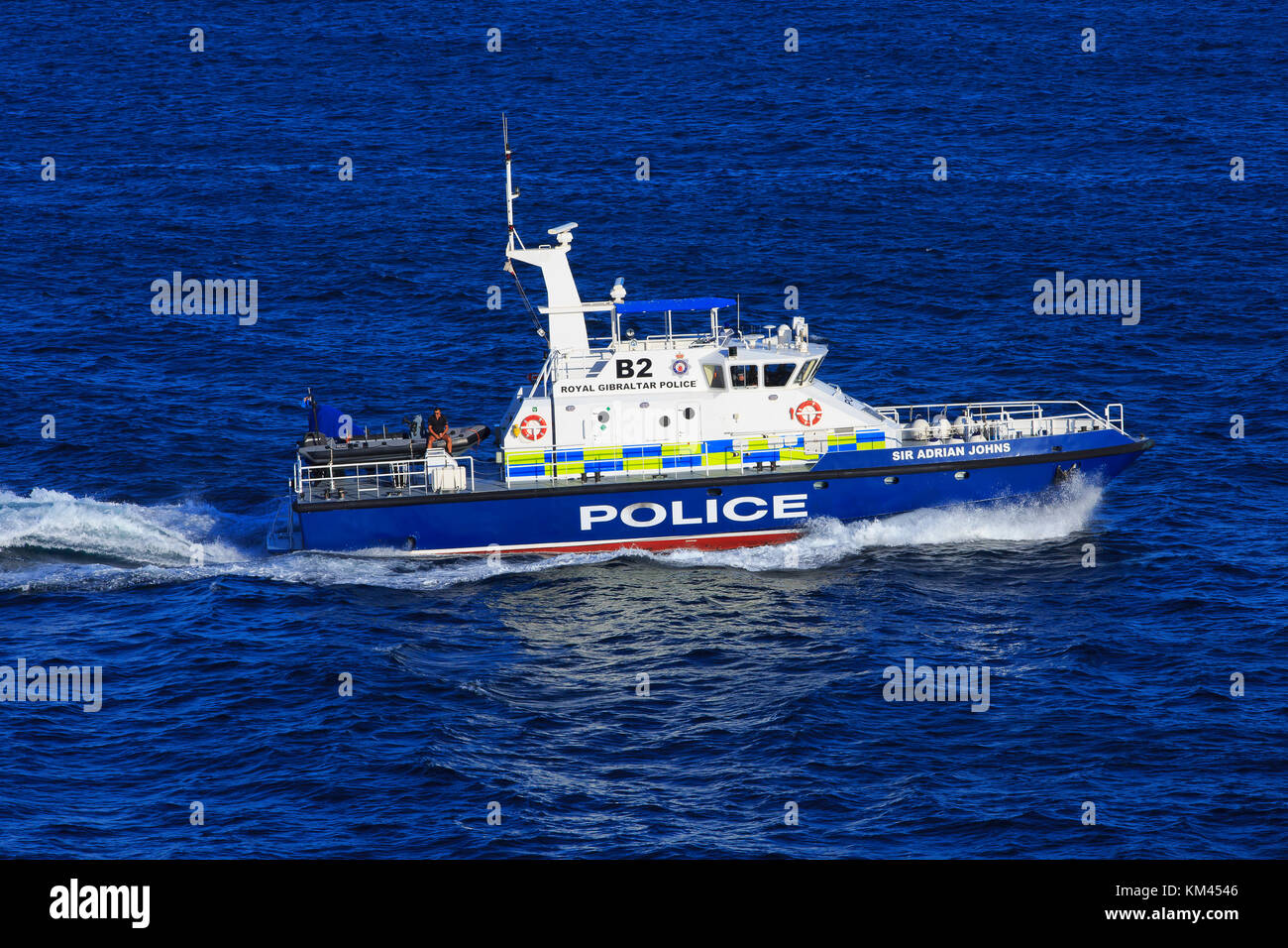 The Sir Adrian Johns (B2) of the Royal Gibraltar Police Marine Section cruising past Europa Point, Gibraltar - Stock Image