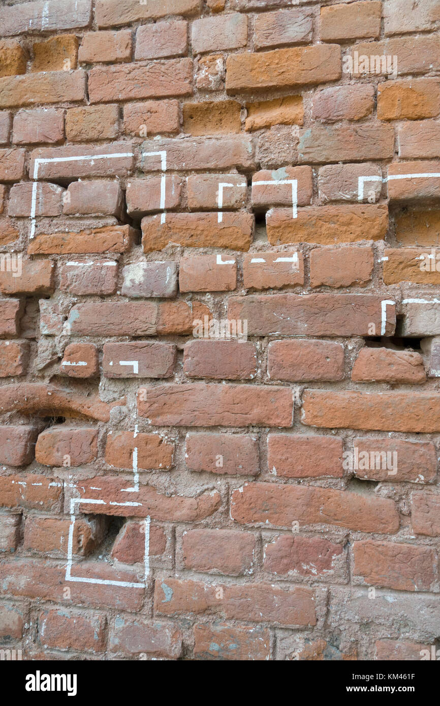 Machine gun bullet holes in brick wall at Jallianwala Bagh, Amritsar, where the British Army opened fire and massacred - Stock Image