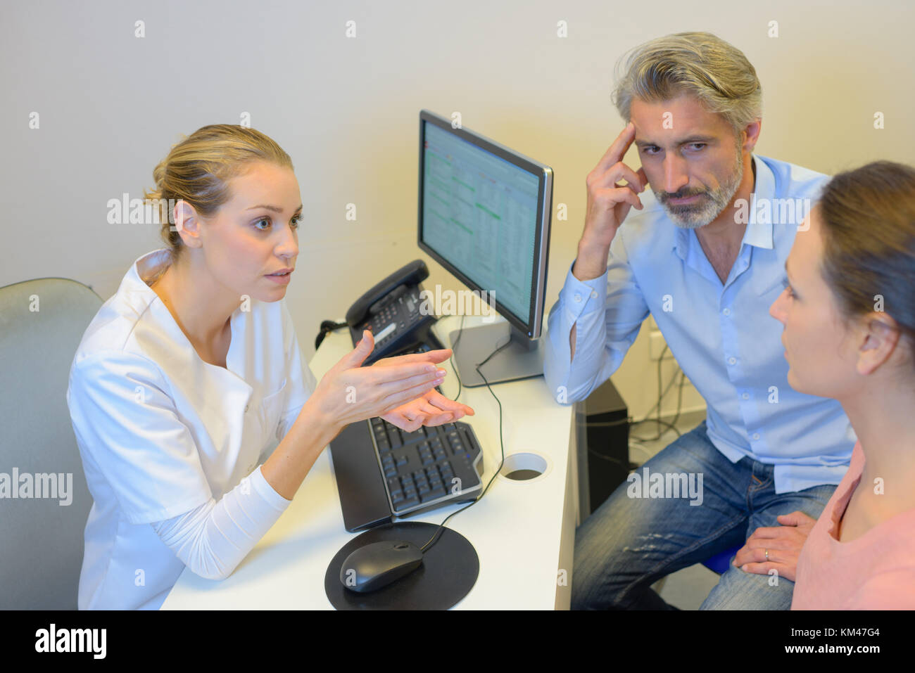 Doctor insisting point to patient - Stock Image