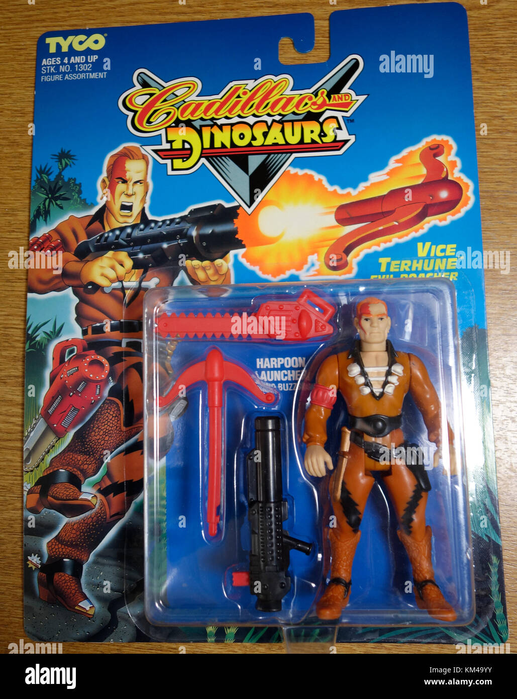 Cadillacs and Dinosaurs carded figure - Stock Image