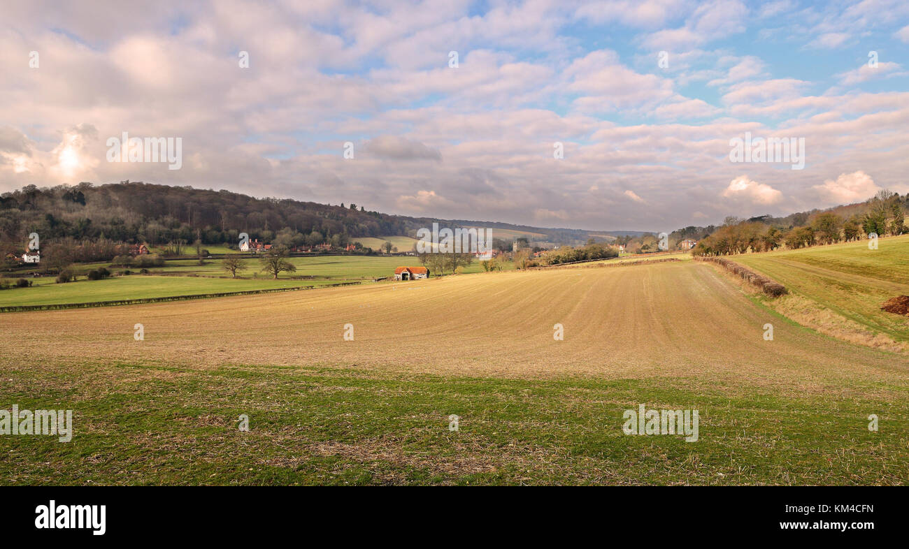 An English Landscape in the Chiltern Hills with the Village of Hambleden in the distance - Stock Image