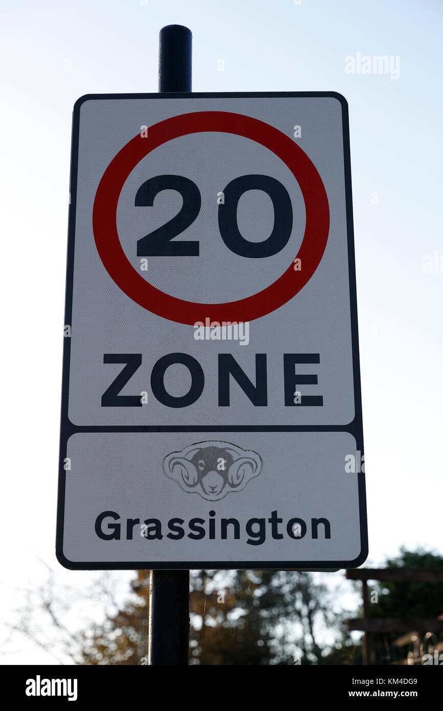 20 MPH speed Zone Sign in use in the Market Town of Grassington in the Craven district of North Yorkshire, UK Stock Photo