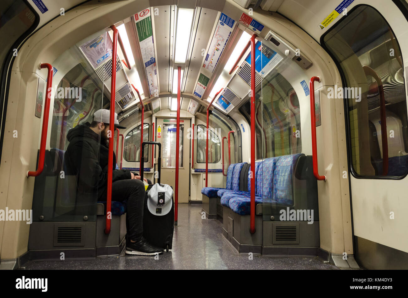 A quiet carriage on the London Underground. - Stock Image