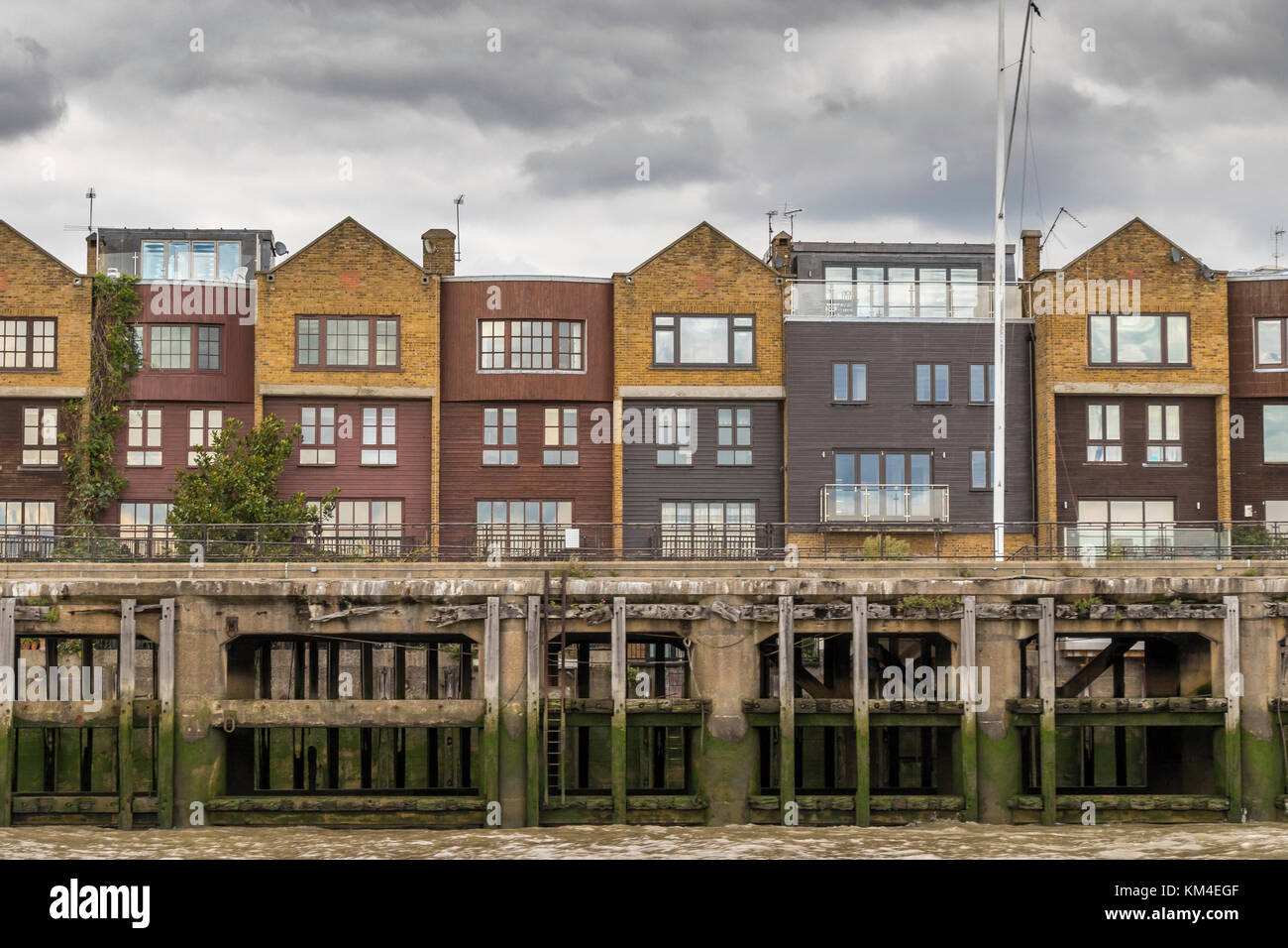 Riverside Apartments and Flats Overlooking the River Thames, Docklands ,London - Stock Image