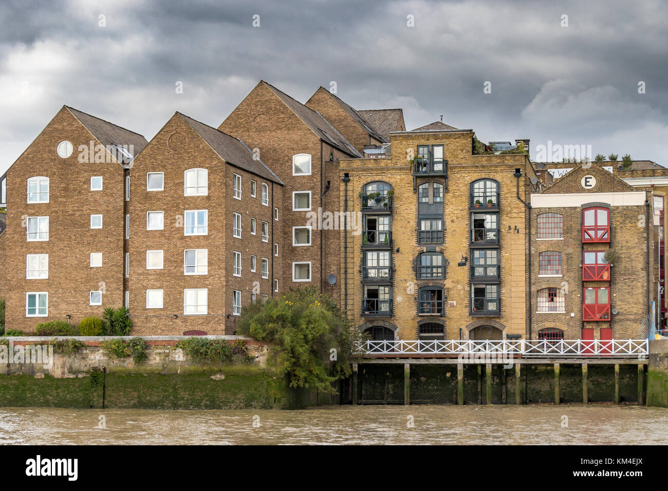 Riverside Apartments and Flats Overlooking the River Thames, Docklands ,London Stock Photo