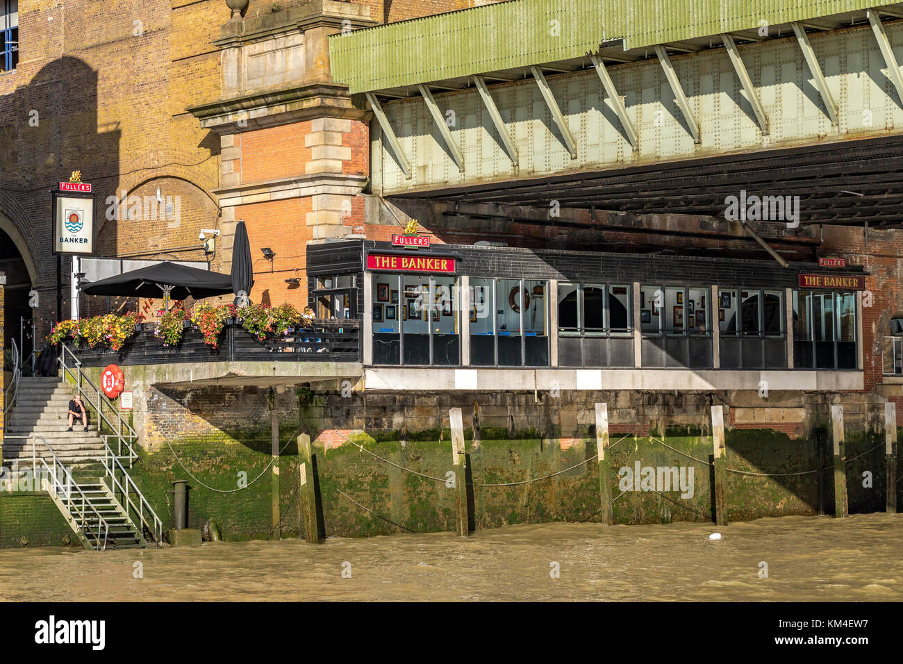 'The Banker' a London Riverside pub in The City Of London ,  located next to Cannon St Railway  Bridge - Stock Image