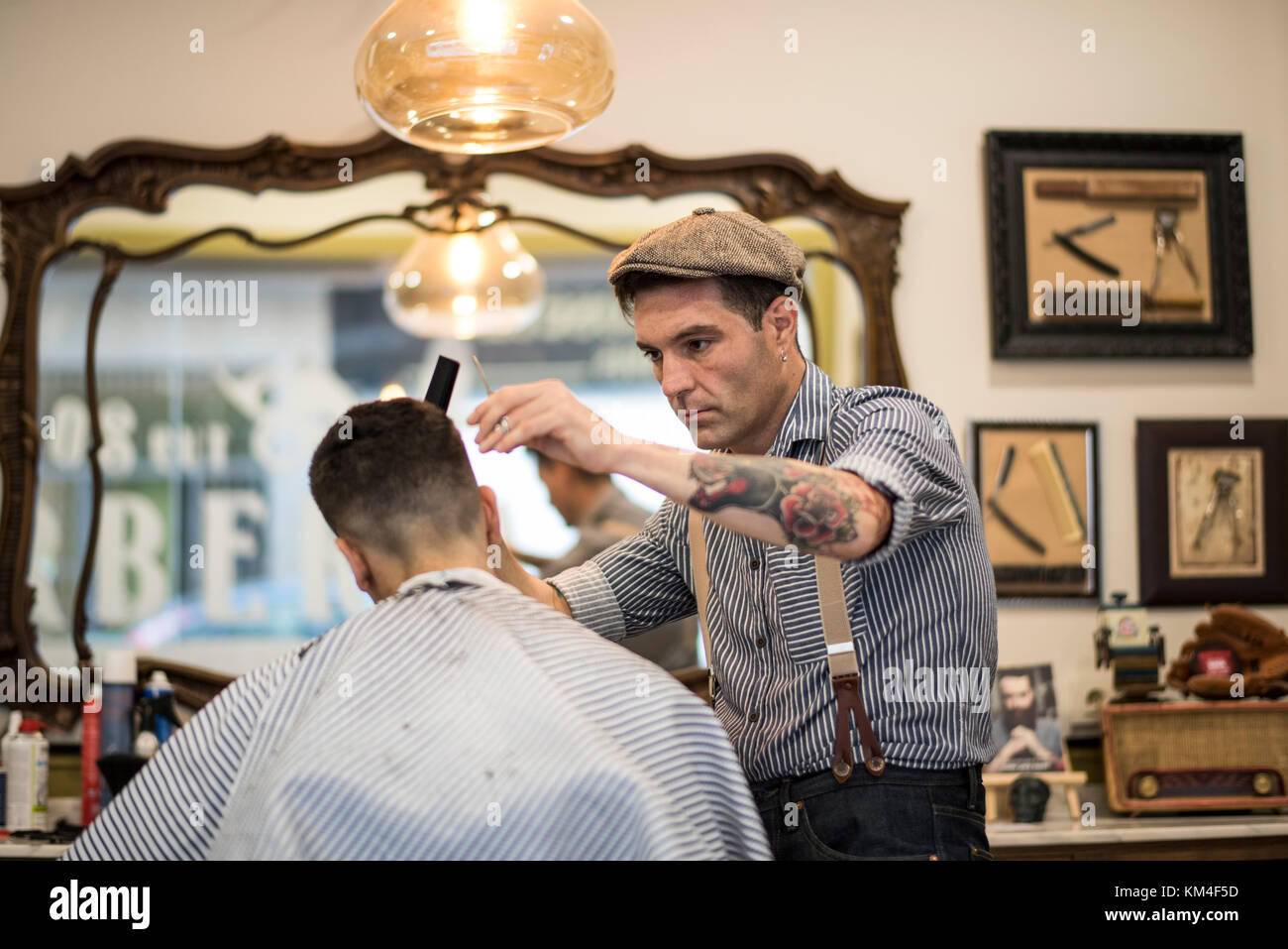 Barber shop, man cuts person hair Stock Photo