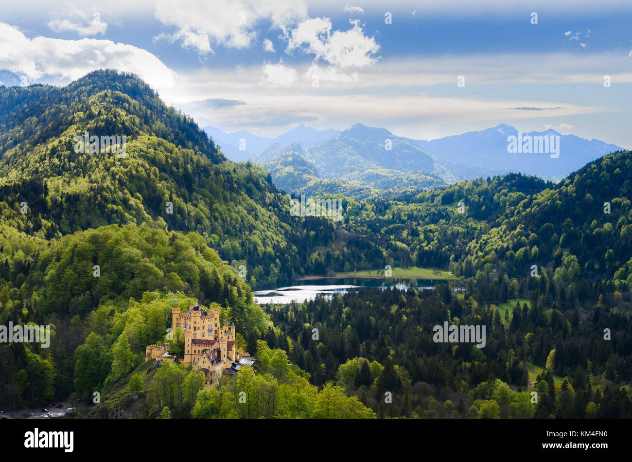 Panorama of the  Alpsee lake and its forest, under a partially cloudy sky, near Neuschwanstein, in Bavaria, Germany. - Stock Image
