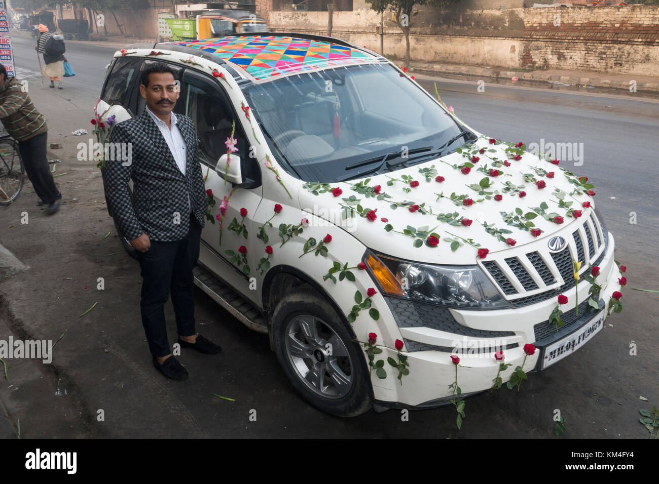 Vehicle decorations stock photos vehicle decorations stock images punjabi bridegroom stands next to wedding suv vehicle decorated in roses in amritsar india junglespirit Gallery