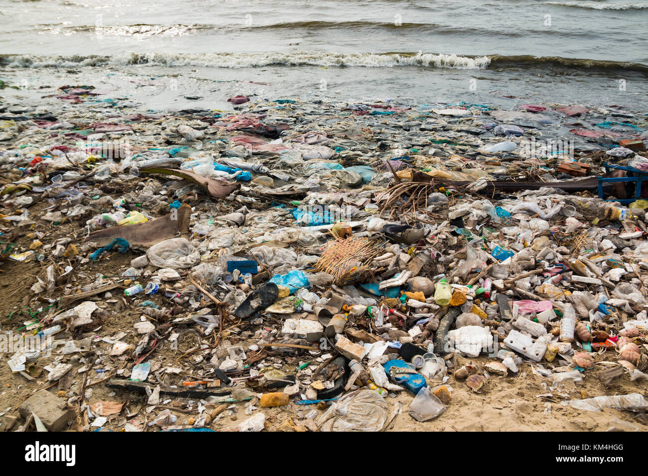 Polluted beach in a fishing village in Vietnam, environmental pollution concept - Stock Image