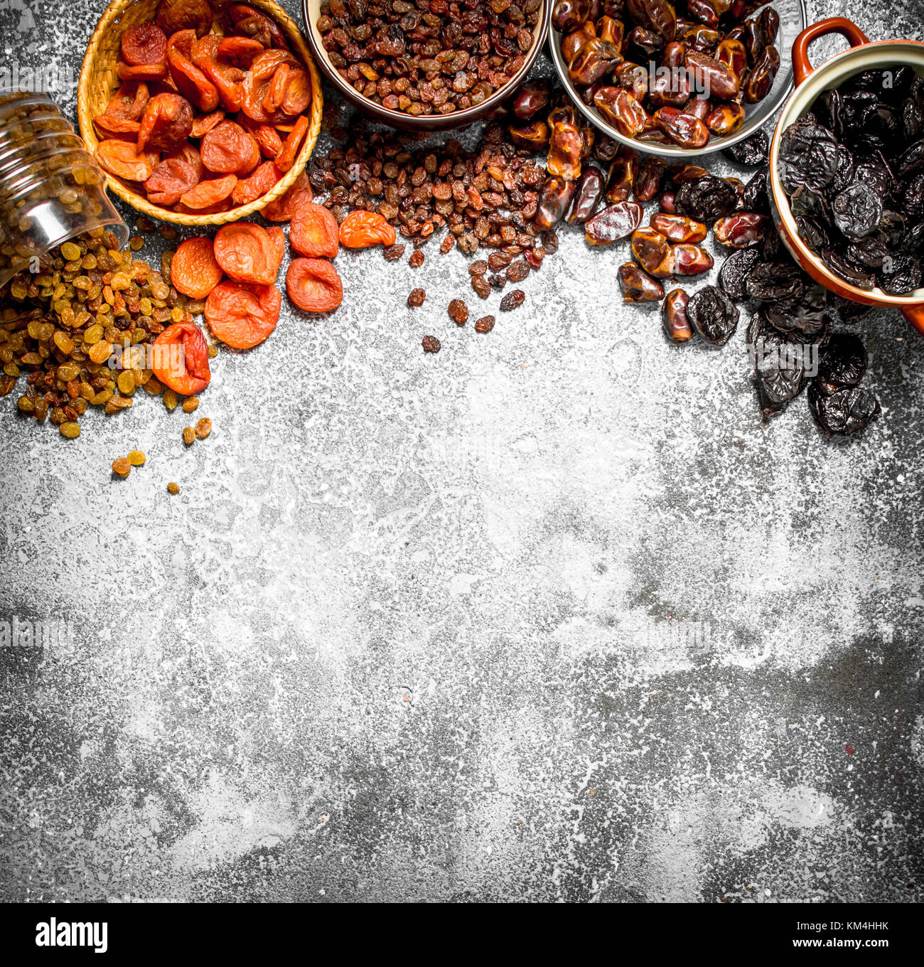 Various dried fruit in bowls. On rustic background . - Stock Image