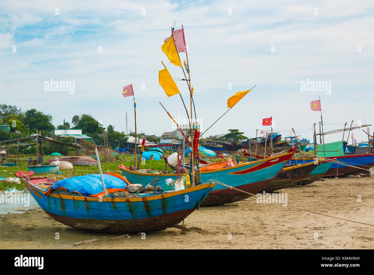Traditional Vietnamese fishing coracles on beach, boats in fishing village, Mui Ne, Vietnam - Stock Image